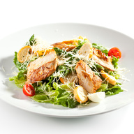 Tossed green salad topped with chicken breast
