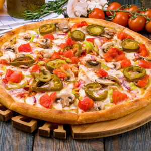Refried beans, canadian bacon, cheddar & mozzarella cheese, onions, olives, jalapenos, beef with cold lettuce & tomato